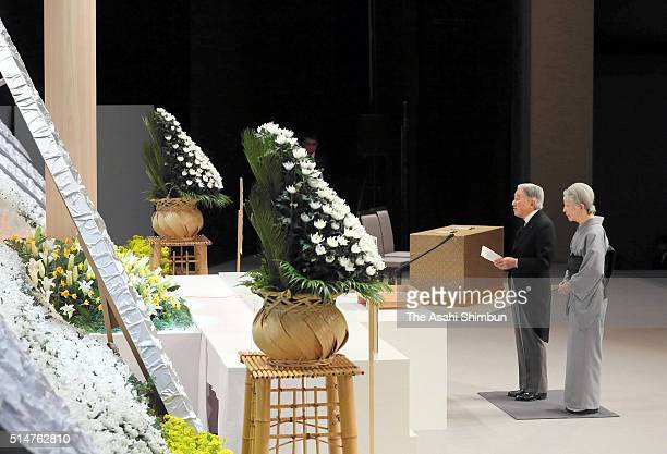 Emperor Akihito and Empress Michiko address in front of the altar during the national memorial service at the National Theatre on March 11 2016 in...