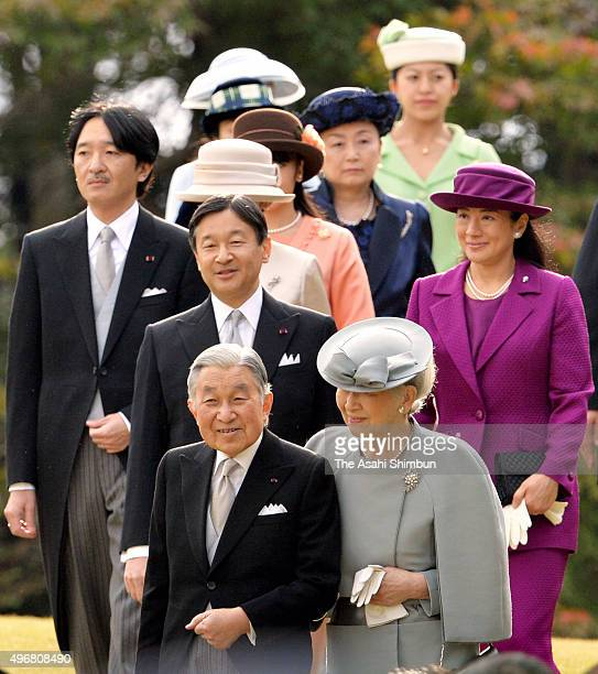 Emperor Akihito and Empress Michiko and other royal family members walk toward the guests during the Autumn Garden Party at the Akasaka Imperial...