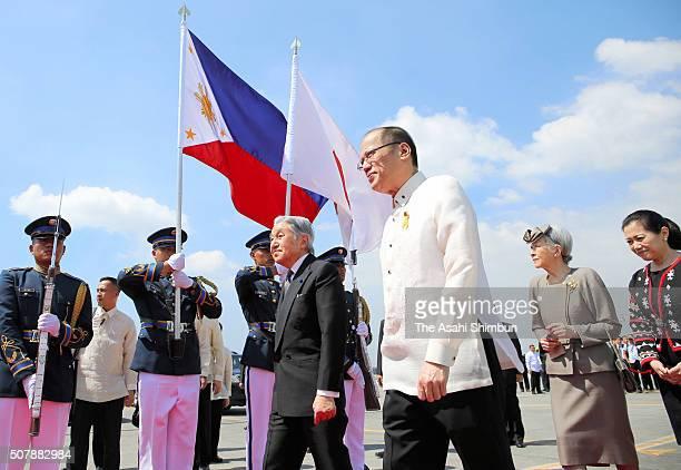 Emperor Akihito and Empress Michiko are escorted by Philippines President Benigno Aquino on departure at the Ninoy Aquino International Airport on...