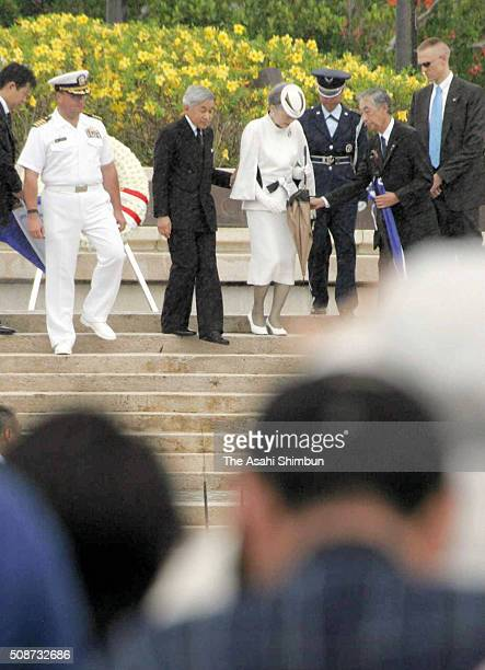 Emperor Akihito and Empress Michiko are seen after offering a wreath at the Court of Honor and Flag Circle a memorial to the American and Marianas...