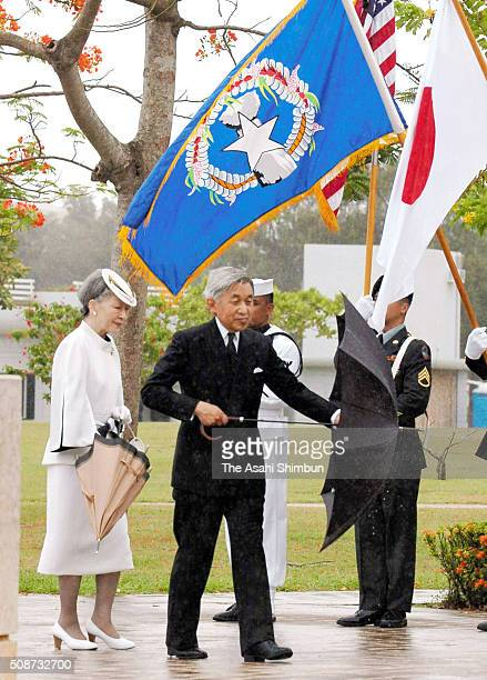 Emperor Akihito and Empress Michiko are seen at the Court of Honor and Flag Circle a memorial to the American and Marianas people who died in the...