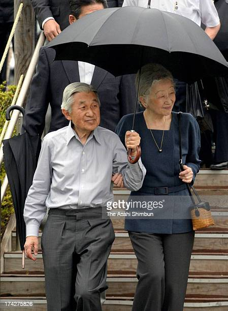 Emperor Akihito and Empress Michiko are seen during their visit to Iitate village's three elementary schools joint temporary building on July 22 2013...