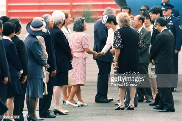 Emperor Akihito and Empress Michiko are seen on arrival at the JFK International Airport on June 15 1994 in New York