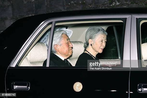 Emperor Akihito and Empress Michiko are seen on departure from the Imperial Palace for a condolence visit to Prince Mikasa's residence on October 27...