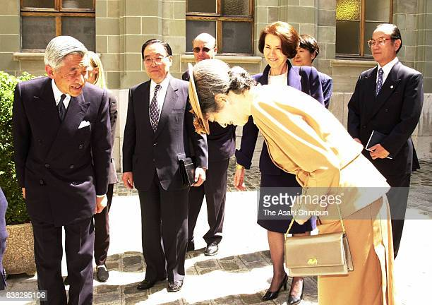 Emperor Akihito and Empress Michiko are seen Swiss President Adolf Ogi on May 22 2000 in Geneva Switzerland