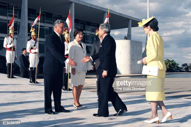 Emperor Akihito and Empress Michiko are welcomed by Brazilian President Fernando Henrique Cardoso and his wife Ruth Cardoso prior to the welcome...