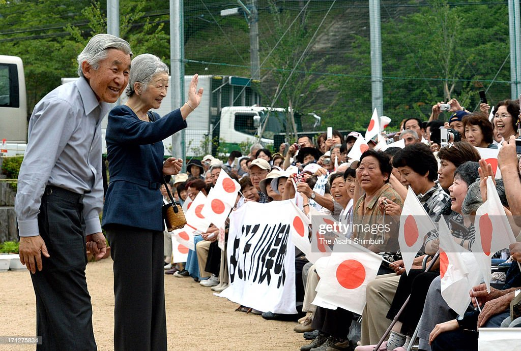 Emperor Akihito (1L) and <a gi-track='captionPersonalityLinkClicked' href=/galleries/search?phrase=Empress+Michiko&family=editorial&specificpeople=158725 ng-click='$event.stopPropagation()'>Empress Michiko</a> (2L) are welcomed by evacuees of the magnitude 9.0 earthquake and subsequent tsunami and the nuclear accident during their visit to Iitate village's three elementary schools joint temporary building on July 22, 2013 in Kawamata, Fukushima, Japan. Iitate Village, located within the exclusion zone of the crippled Fukushima Daiichi Nuclear Plant, all the residents have been evacuated.