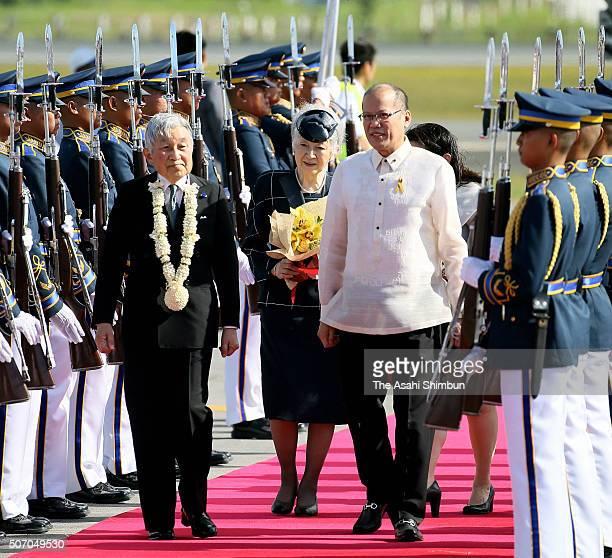 Emperor Akihito and Empress Michiko are welcomed by Philippines President Benigno Aquino and his sister Aurora Corazon AquinoAbellada at the Ninoy...