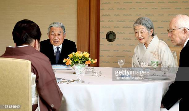 Emperor Akihito and Empress Michiko attend a tea ceremony with the Japan Art Academy award winners at the Imperial Palace on July 8 2013 in Tokyo...