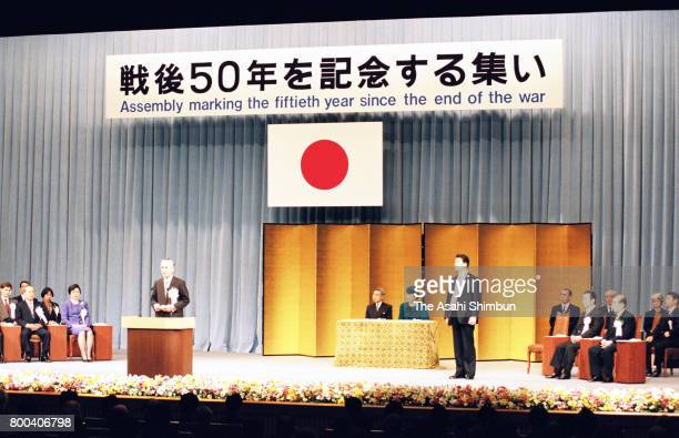 Emperor Akihito and Empress Michiko attend an assembly marking the 50th year since the end of the WWII at the National Theatre on December 23 1995 in...