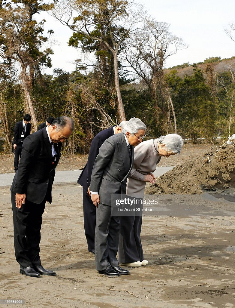 Emperor Akihito (2nd R) and <a gi-track='captionPersonalityLinkClicked' href=/galleries/search?phrase=Empress+Michiko&family=editorial&specificpeople=158725 ng-click='$event.stopPropagation()'>Empress Michiko</a> (1st R) bow at the landslide site to commemorate the victims during their visit to landslide devasted Izu Oshima island on February 28, 2014 in Oshima, Tokyo, Japan.