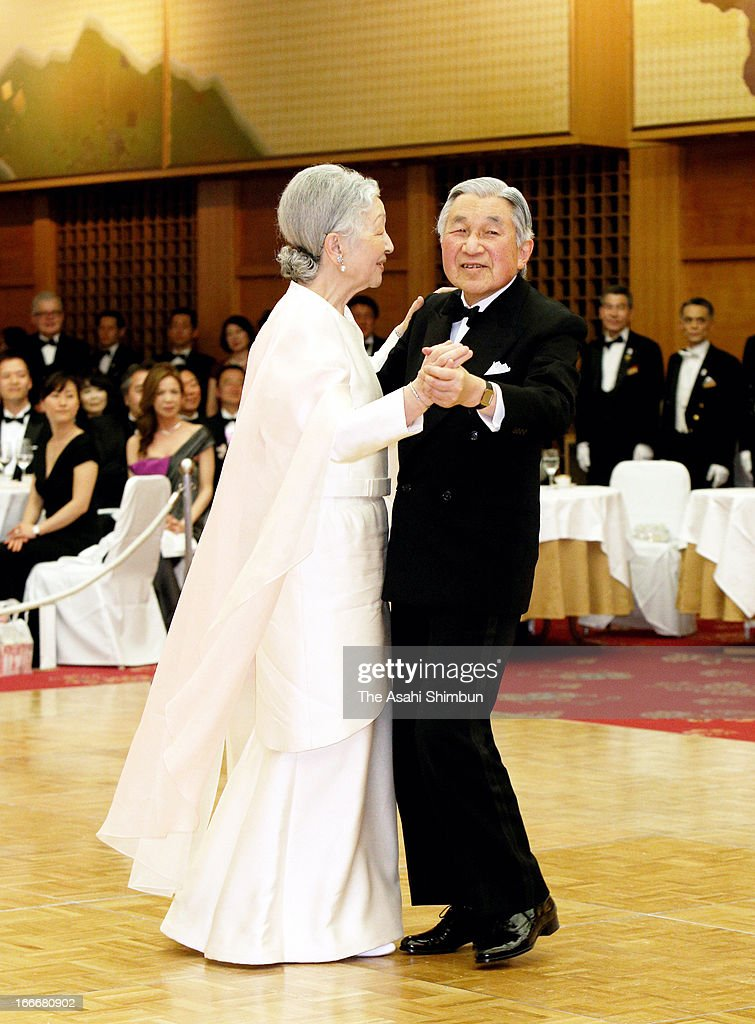 Emperor Akihito and Empress Michiko dance during a ceremony to celebrate the 60th anniversary of the foundation of the International Ladies Benevolent Society at Hotel Okura on April 12, 2013 in Tokyo, Japan.