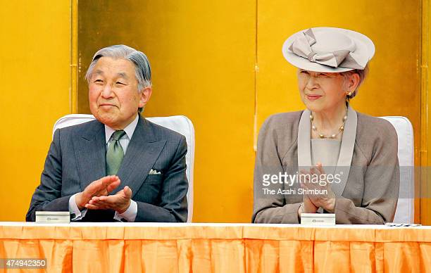 Emperor Akihito and Empress Michiko enjoy the chorus by children during the 50th anniversaary ceremony of the Kodomo No Kuni Amusement Park on May 28...