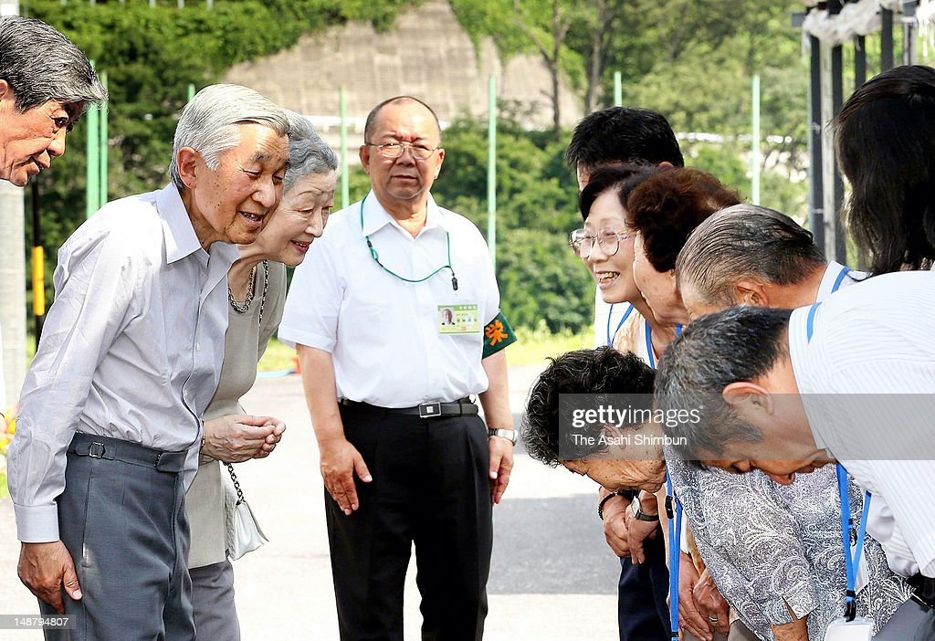 Emperor Akihito and <a gi-track='captionPersonalityLinkClicked' href=/galleries/search?phrase=Empress+Michiko&family=editorial&specificpeople=158725 ng-click='$event.stopPropagation()'>Empress Michiko</a> greet local residents during their visit to Sakae Village on July 19, 2012 in Sakae, Nagano, Japan. Sakae village has been still suffered from the aftermath of the strong earthquake in March 2011, 51 households still have to live at temporary housing.