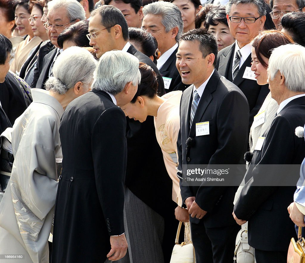 Emperor Akihito and <a gi-track='captionPersonalityLinkClicked' href=/galleries/search?phrase=Empress+Michiko&family=editorial&specificpeople=158725 ng-click='$event.stopPropagation()'>Empress Michiko</a> greet to astronaut <a gi-track='captionPersonalityLinkClicked' href=/galleries/search?phrase=Akihiko+Hoshide&family=editorial&specificpeople=5329772 ng-click='$event.stopPropagation()'>Akihiko Hoshide</a> (3R) during the annual spring garden party at Akasaka Palace on April 18, 2013 in Tokyo, Japan.