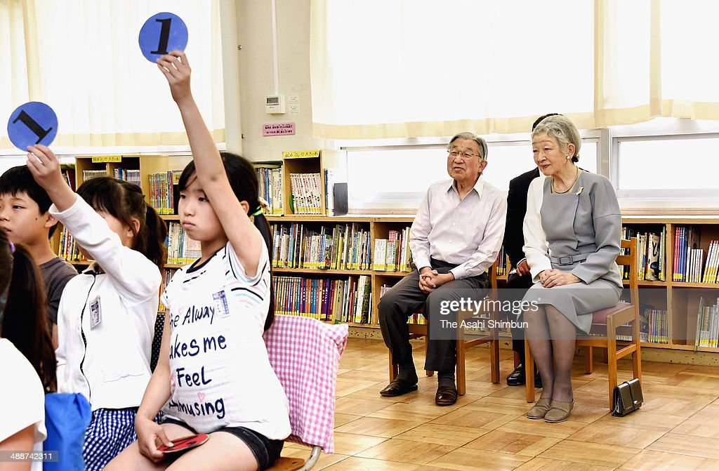 Emperor Akihito and <a gi-track='captionPersonalityLinkClicked' href=/galleries/search?phrase=Empress+Michiko&family=editorial&specificpeople=158725 ng-click='$event.stopPropagation()'>Empress Michiko</a> inspect a class at Hananoki Elementary School on May 8, 2014 in Tokyo, Japan. Emperor and Empress had inspected elementary schools around the Boy's day in the past, and the visit will be taken over by their sons from next year.