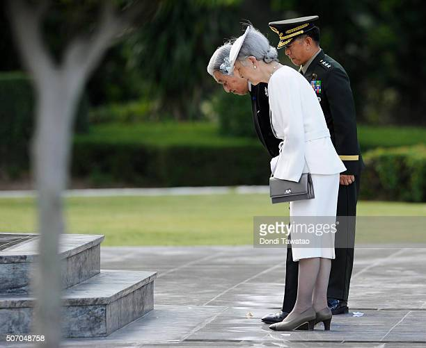 Emperor Akihito and Empress Michiko is escorted by Armed Forces of the Philippines commanding general Eduardo Ano at the Tomb of the Fallen Soldiers...