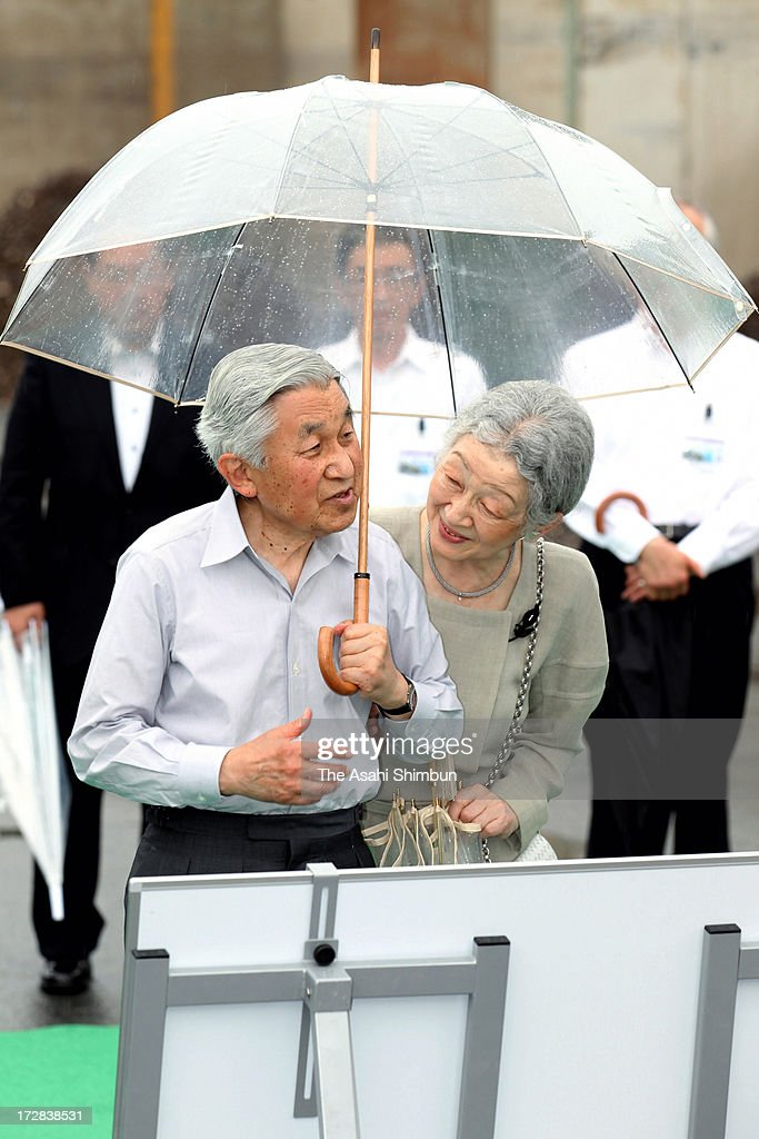Emperor Akihito and <a gi-track='captionPersonalityLinkClicked' href=/galleries/search?phrase=Empress+Michiko&family=editorial&specificpeople=158725 ng-click='$event.stopPropagation()'>Empress Michiko</a> listen an explanation by a staff of Taiheiyo Cement Ofunato Factory on July 5, 2013 in Ofunato, Iwate, Japan.