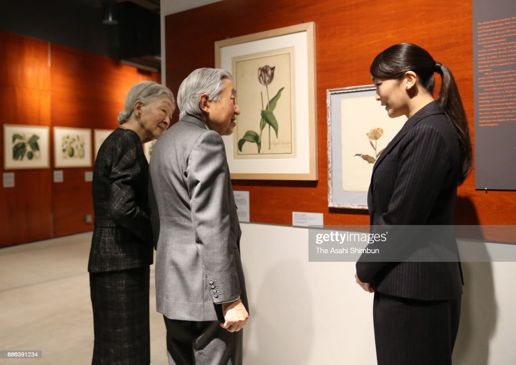 Emperor Akihito and Empress Michiko listen to the explanation from Princess Mako of Akishino during their visit to the 'The Golden Age of Botanical Art - Flowers from the Collections of the Royal Botanic Gardens, Kew' at the Intermediatheque on December 2, 2017 in Tokyo, Japan.