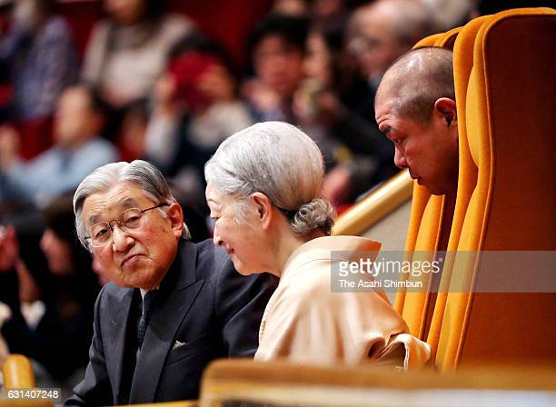 Emperor Akihito and Empress Michiko listens to explanation by Japan Sumo Association President and stable master Hakkaku as they enjoy watching bouts...