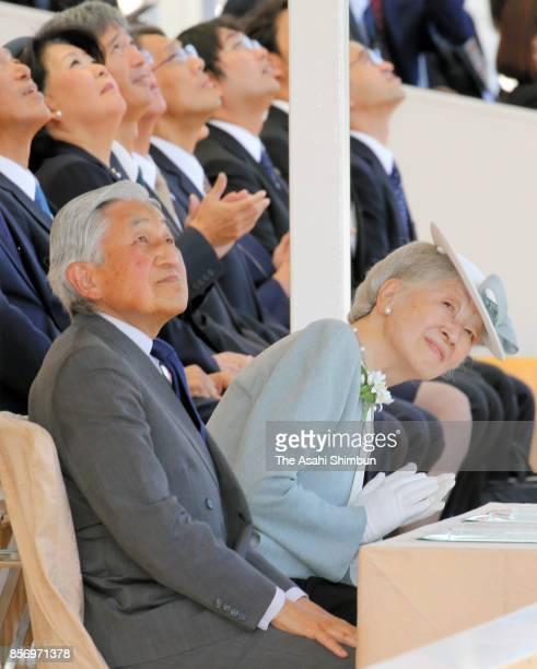 Emperor Akihito and Empress Michiko look up Blue Impulse Japan Air SelfDefense Force's Acrobatic Flight Performance team fly over the stadium during...
