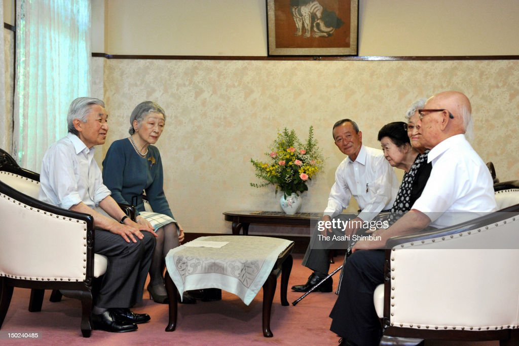 Emperor Akihito (1L) and <a gi-track='captionPersonalityLinkClicked' href=/galleries/search?phrase=Empress+Michiko&family=editorial&specificpeople=158725 ng-click='$event.stopPropagation()'>Empress Michiko</a> (2L) meet the survivors of the March 1945 Bombing of Tokyo at Tomioka Hachimanngu Shrine on August 12, 2012 in Tokyo, Japan.