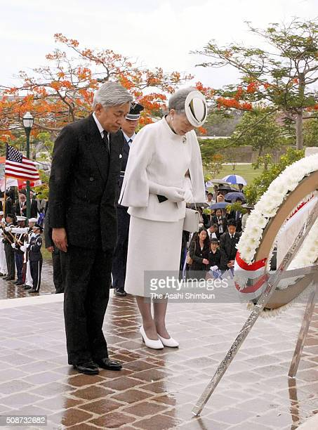 Emperor Akihito and Empress Michiko offer a wreath at the Court of Honor and Flag Circle a memorial to the American and Marianas people who died in...
