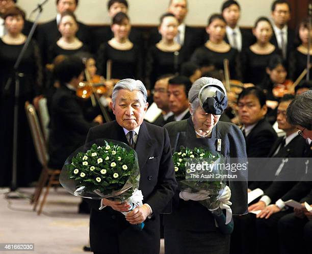 Emperor Akihito and Empress Michiko offer flowers to an altar during the memorial ceremony to mark the 20th anniversary of the Great Hanshin...