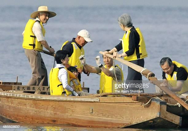 Emperor Akihito and Empress Michiko row a boat for his grandson Prince Hisahito and Princess Kiko of Akishino during his stay at the Hayama Imperial...