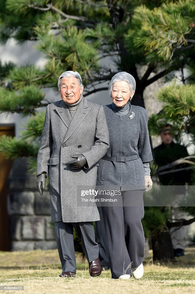 Emperor Akihito and Empress Michiko stroll outside the Hayama Imperial Villa on February 5, 2016 in Hayama, Kanagawa, Japan.