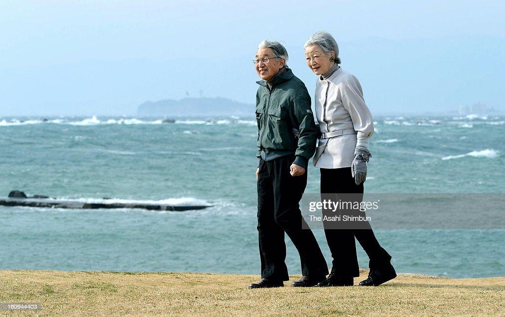Emperor Akihito and Empress Michiko take a walk a coast near Hayama Villa on February 7, 2013 in Hayama, Kanagawa, Japan.