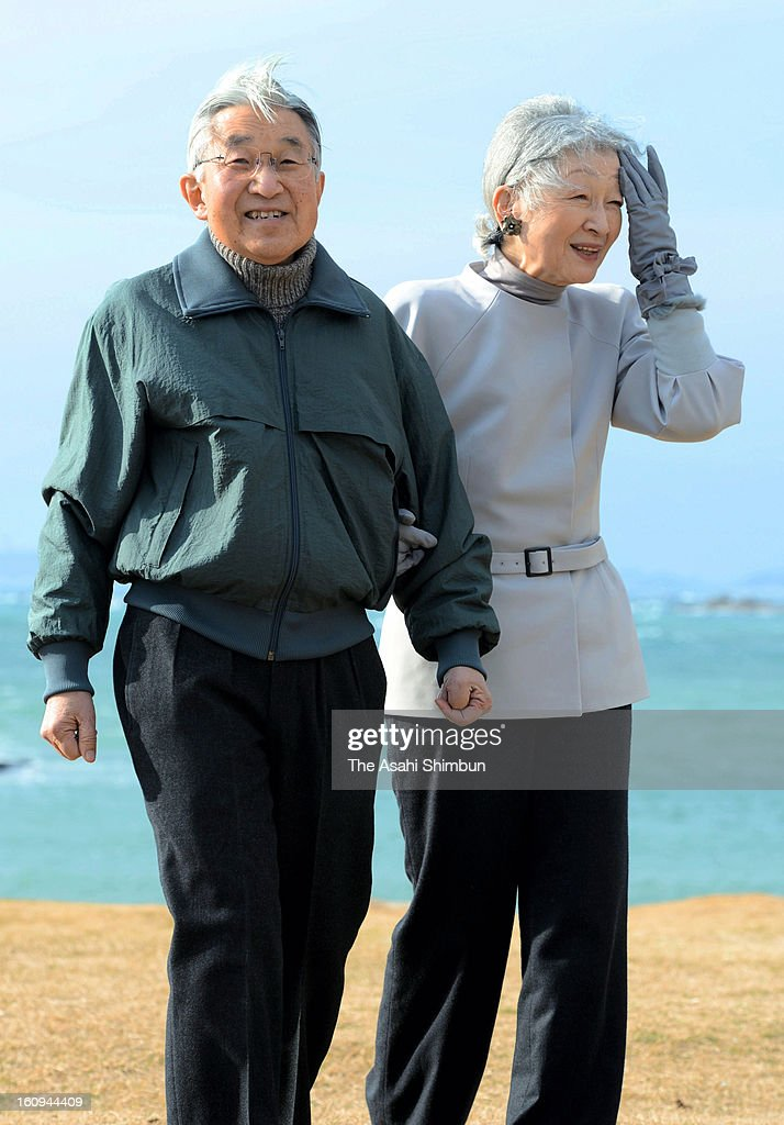 Emperor Akihito and Empress Michiko take a walk a coast near Hayama Villa on February 7, 2013 in Hayama, Kanagawa, Japan.