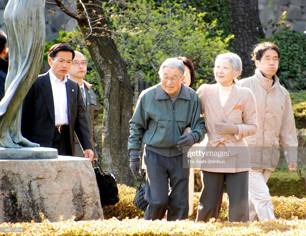 Emperor Akihito and <a gi-track='captionPersonalityLinkClicked' href=/galleries/search?phrase=Empress+Michiko&family=editorial&specificpeople=158725 ng-click='$event.stopPropagation()'>Empress Michiko</a> take a walk outside the Imperial Palace on April 7, 2014 in Tokyo, Japan. The rare appearance surprises runners and commuters.