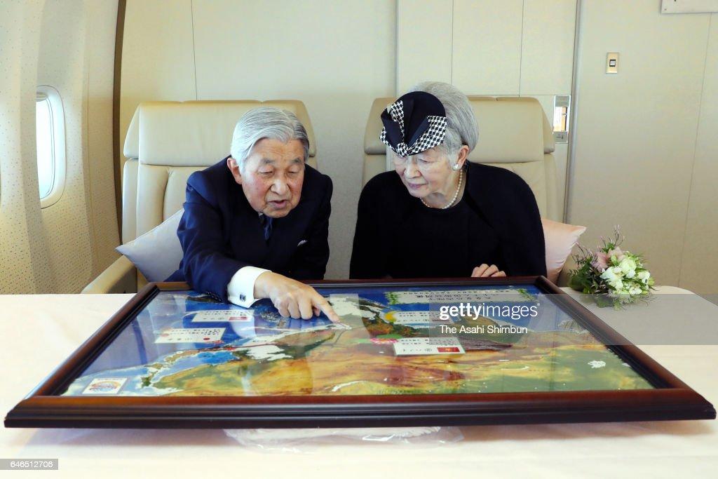 Emperor Akihito and Empress Michiko talk on the way to Vietnam on February 28, 2017 in flight.