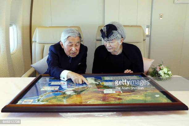 Emperor Akihito and Empress Michiko talk on the way to Vietnam on February 28 2017 in flight