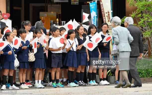 Emperor Akihito and Empress Michiko talk to children at Dogo Onsen hot spring on October 1 2017 in Matsuyama Ehime Japan