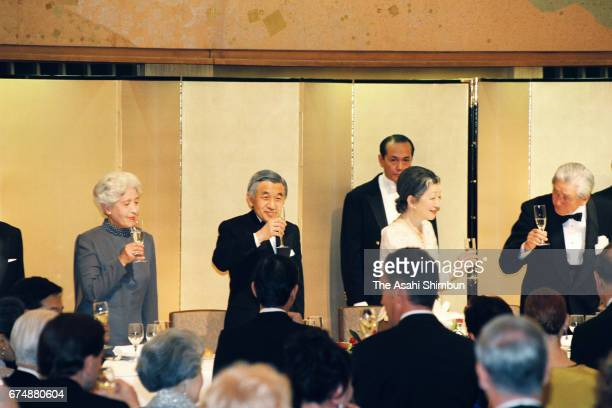 Emperor Akihito and Empress Michiko toast glasses during the reception marking the 80th anniversary of the foundation of the AmericaJapan Society at...