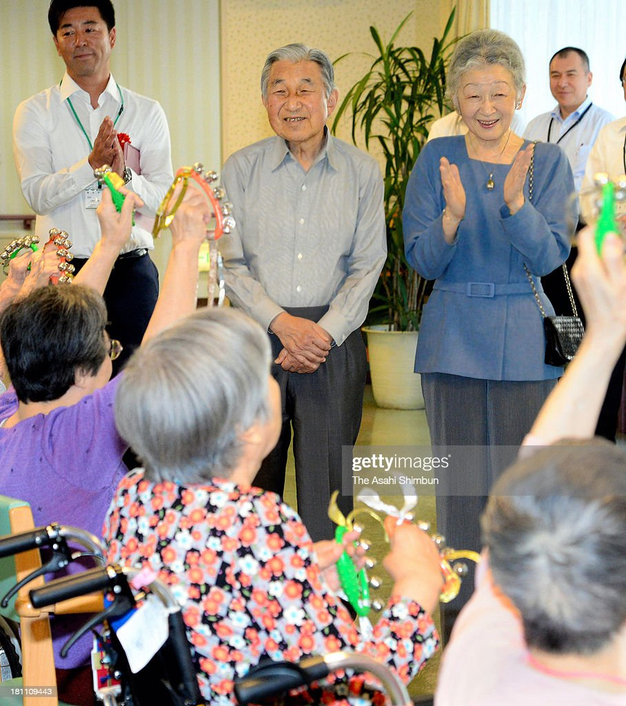 Emperor Akihito (C) and Empress Michiko (R) visit a nursery home on September 19, 2013 in Tokyo, Japan. They have been visiting nursery homes every year ahead of the respect-for-senior-citizens day, the visit will be taken over by Crown Prince or Prince Akishino from 2015.