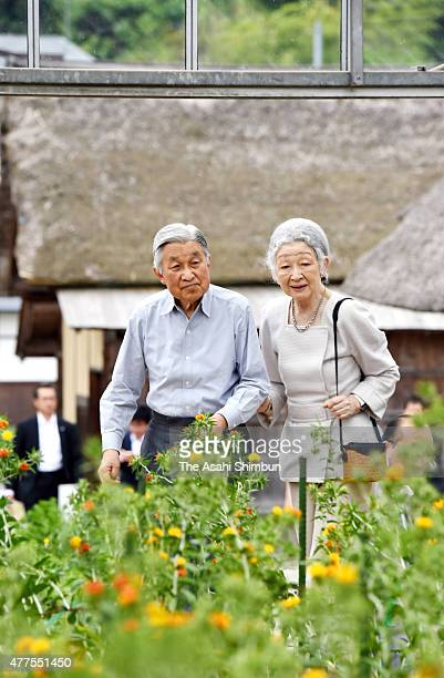 Emperor Akihito and Empress Michiko visit the Benibana Shiryokan Safflower Resource Centre on June 18 2015 in Kahoku Yamagata Japan