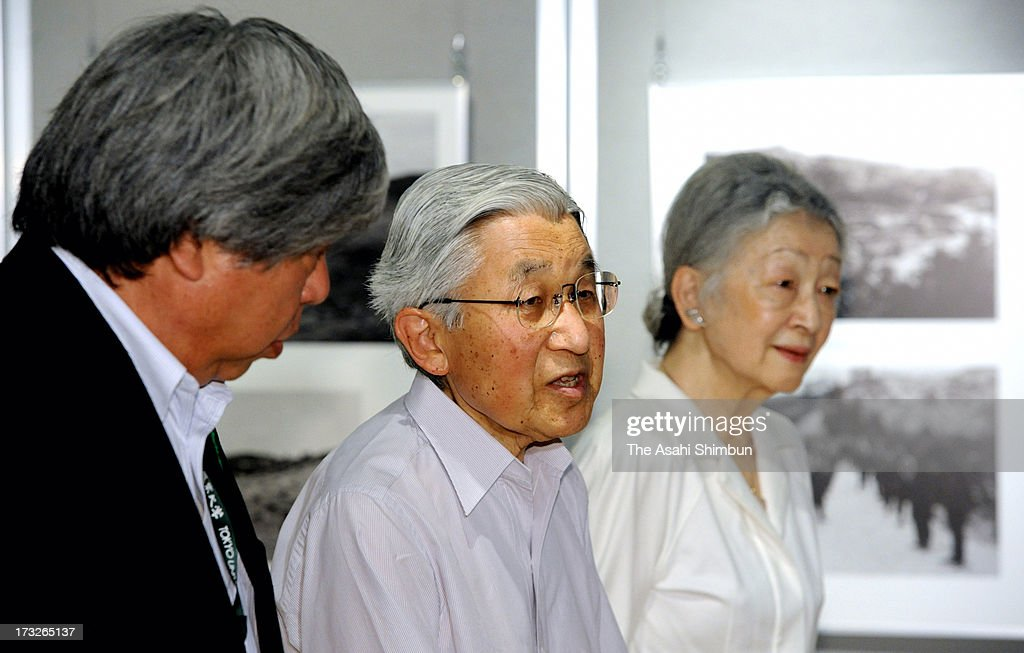 Emperor Akihito (C) and <a gi-track='captionPersonalityLinkClicked' href=/galleries/search?phrase=Empress+Michiko&family=editorial&specificpeople=158725 ng-click='$event.stopPropagation()'>Empress Michiko</a> visit the 'Japanese Forest Restoration' exhibition at Tokyo University of Agriculture on July 10, 2013 in Tokyo, Japan.