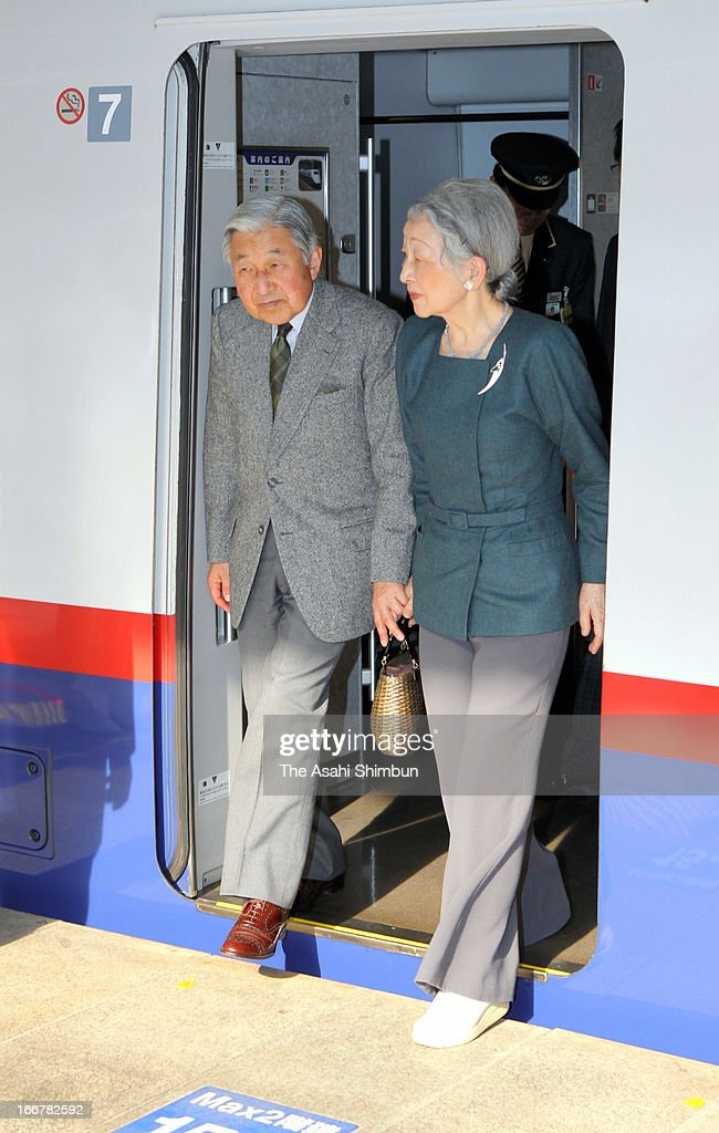 Emperor Akihito and Empress Michiko walk off from Shinkansen bullet train at Tokyo Station on April 16, 2013 in Tokyo, Japan. This is their private trip planned by the staffs of the Imperial Household Agency, in hope of Emperor and Empress being relaxed away from their busy official duties.