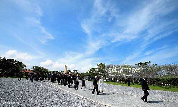 Emperor Akihito and Empress Michiko walk toward the memorial on their visit at the Cemetery for the victims of Battle of Okinawa on June 26 2014 in...