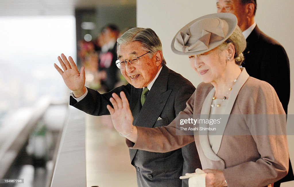 Emperor Akihito and <a gi-track='captionPersonalityLinkClicked' href=/galleries/search?phrase=Empress+Michiko&family=editorial&specificpeople=158725 ng-click='$event.stopPropagation()'>Empress Michiko</a> wave during the 146th Tenno Sho, or Emperor's Cup (Autumn) at Tokyo Racecourse on October 28, 2012 in Tokyo, Japan.