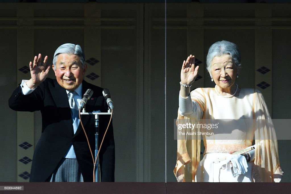 Emperor Akihito and Empress Michiko wave to well-wishers during the New Year celebration at the Imperial Palace on January 2, 2016 in Tokyo, Japan.
