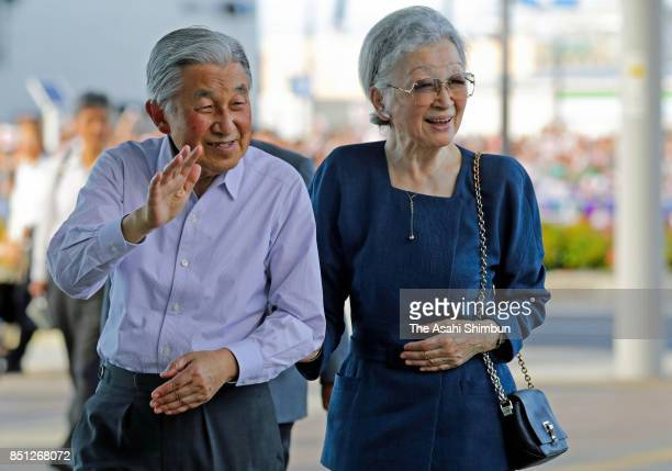 Emperor Akihito and Empress Michiko wave to wellwishers on arrival at Honjo Waseda Station on September 21 2017 in Honjo Saitama Japan