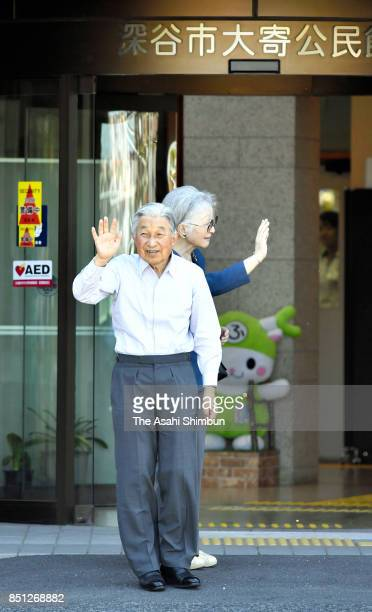 Emperor Akihito and Empress Michiko wave to wellwishers on arrival at Oyori Community Center on September 21 2017 in Fukaya Saitama Japan