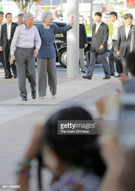 Emperor Akihito and Empress Michiko wave to wellwishers on arrival at Honjo Waseda Station on September 21 2017 in Honjo Saitama Japan