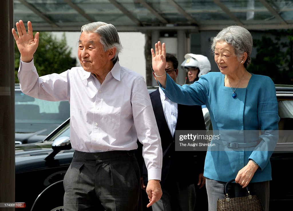 Emperor Akihito and <a gi-track='captionPersonalityLinkClicked' href=/galleries/search?phrase=Empress+Michiko&family=editorial&specificpeople=158725 ng-click='$event.stopPropagation()'>Empress Michiko</a> wave to well-wishers on departure at JR Fukushima Station on July 23, 2013 in Fukushima, Japan. The Emperor and Empress will stay at the Nasu Imperial Villa in Tochigi till July 26.
