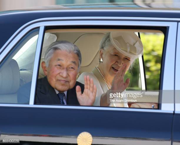 Emperor Akihito and Empress Michiko wave to wellwishers on departure at Matsuyama Airport on September 29 2017 in Matsuyama Ehime Japan