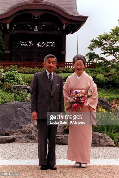 Emperor Akihito and Empress Michiko who is wearing a traditional Japanese Kimono pose for a photograph in front of the ChokushiMon building in the...